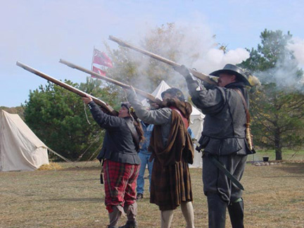 this is a picture of me, my friend Jay, and my other friend Cory. We were demonstrating the Matchock musket drill. In this picture we'd just finished firing and you can see the puffs of smoke coming from the muzzle and slightly drifting off into the wind. That was a great day! All three muskets went off!